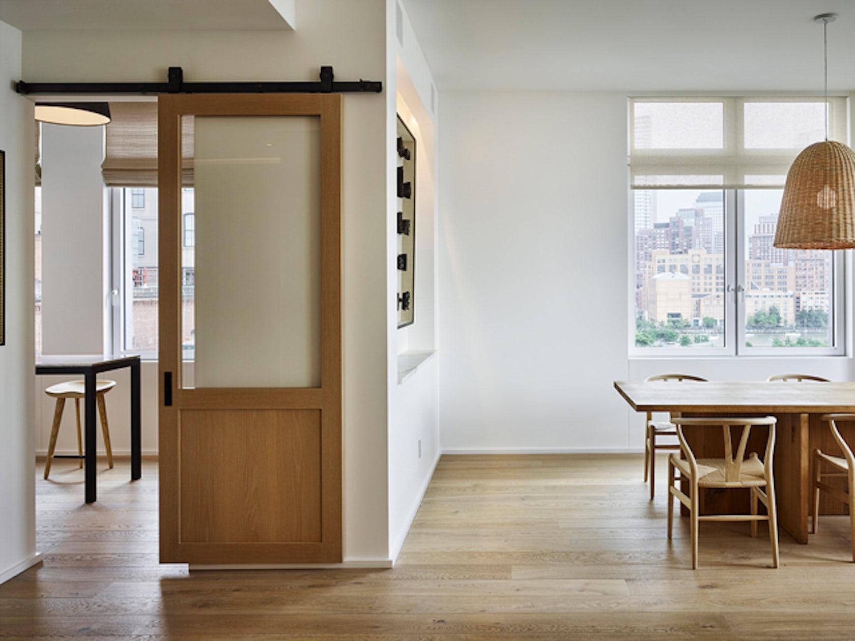 River loft architizer for Sliding door design for kitchen