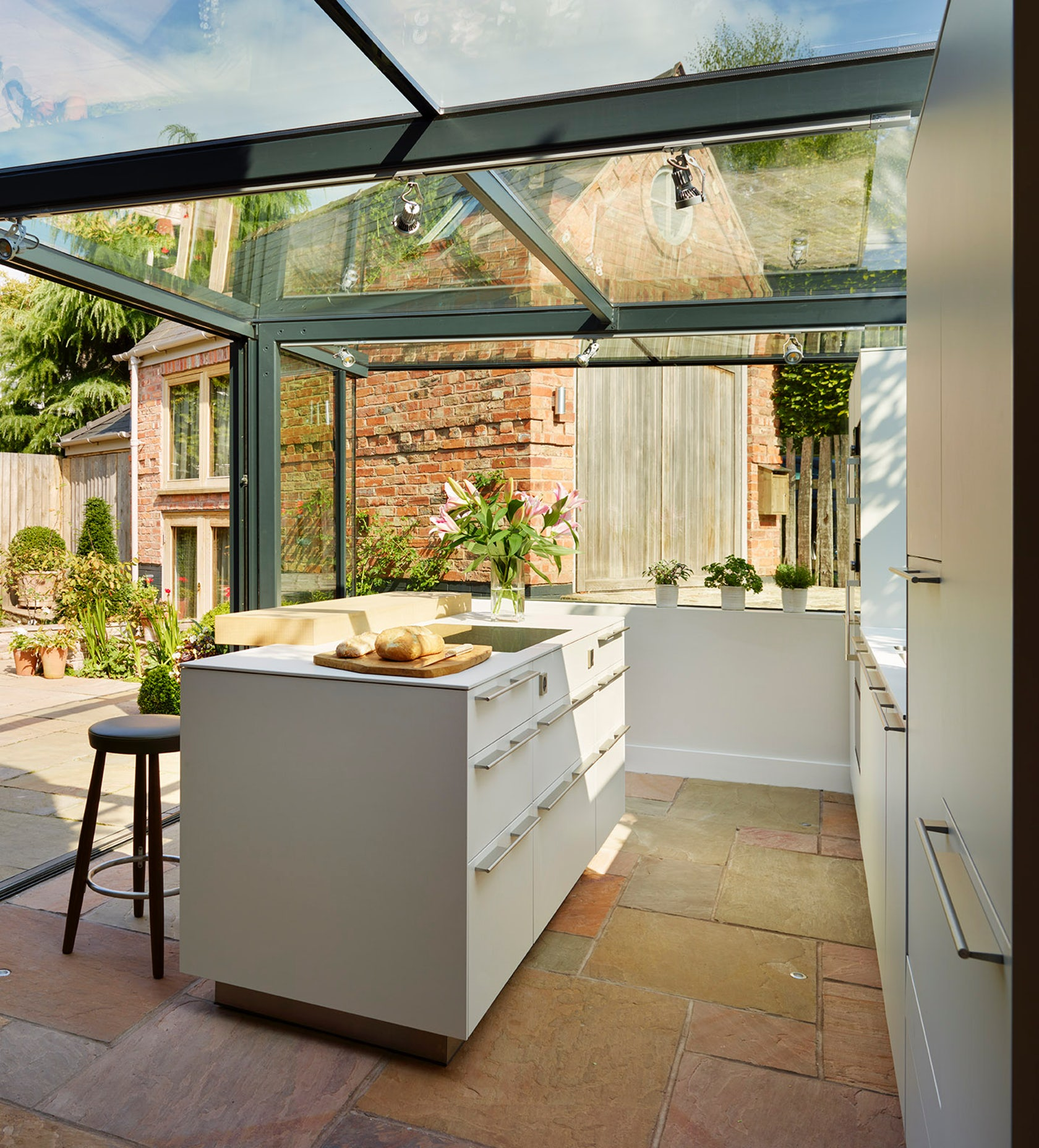 Glass box extension on thatched cottage kitchen for Cottage kitchen extensions