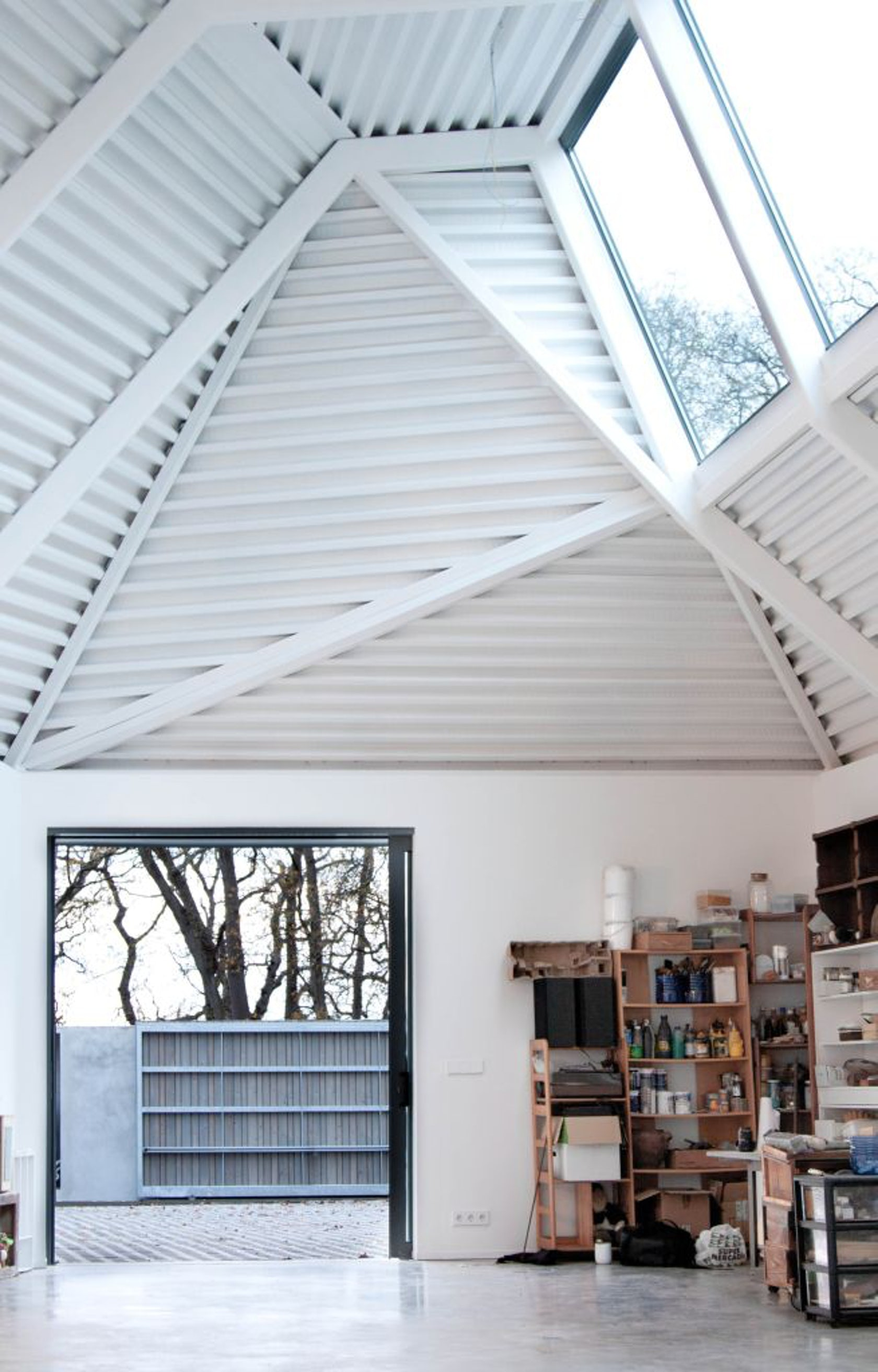 Single family house and atelier architizer for Atelier arquitectura