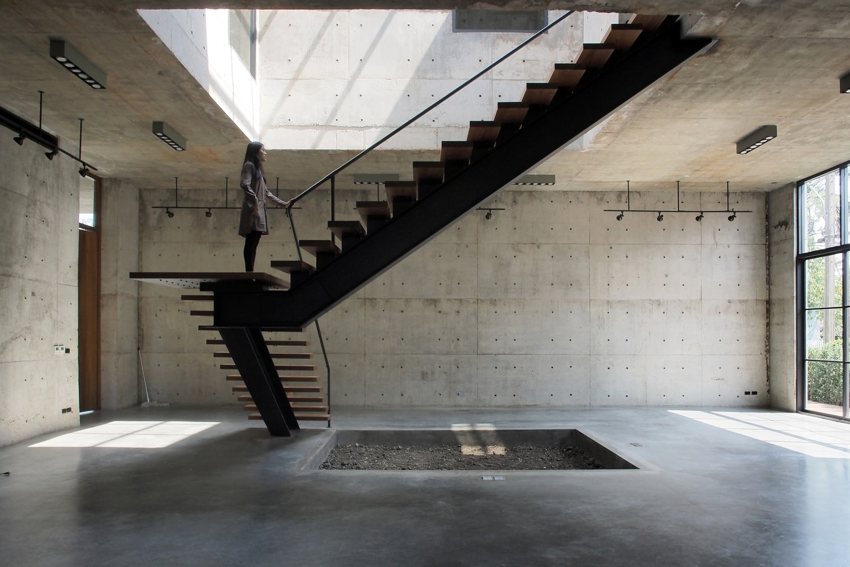 Solid Concrete Studio + Gallery By ASWA Features A Mono Stringer  Cantilevered Staircase With A Single Landing And Metal Railing. Set In  Bangkok, This Type ...