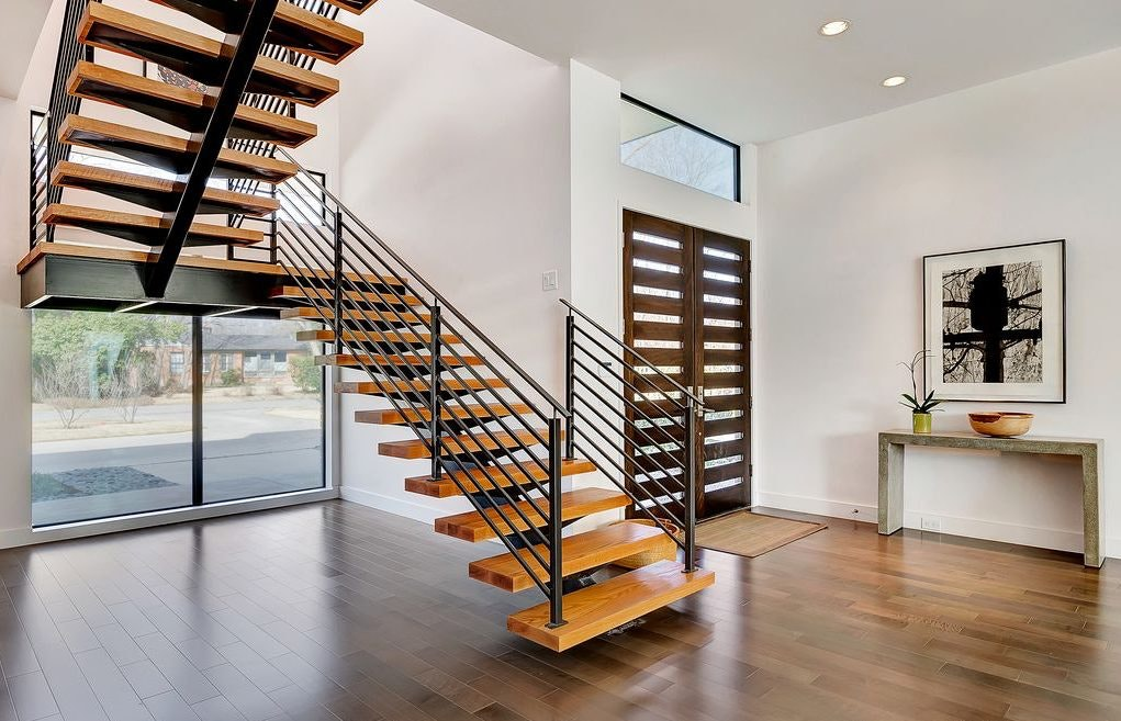 Mono Stringer Floating Staircases With Metal Railing And Spindles; Image  Via Eva Furniture