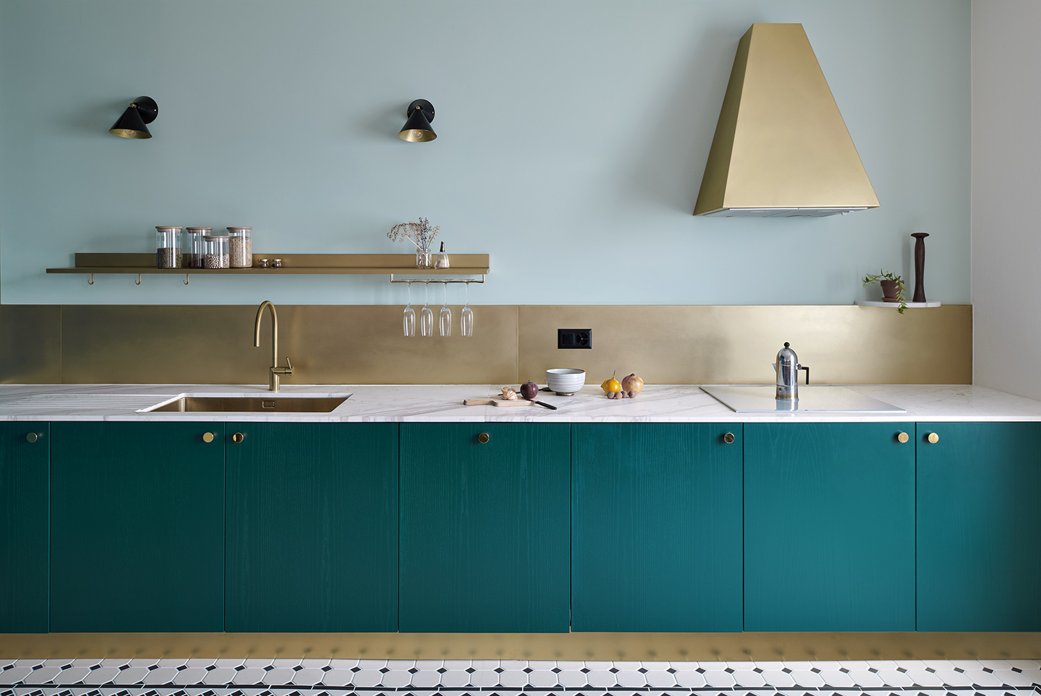 Brass and teal meet in a Swiss kitchen
